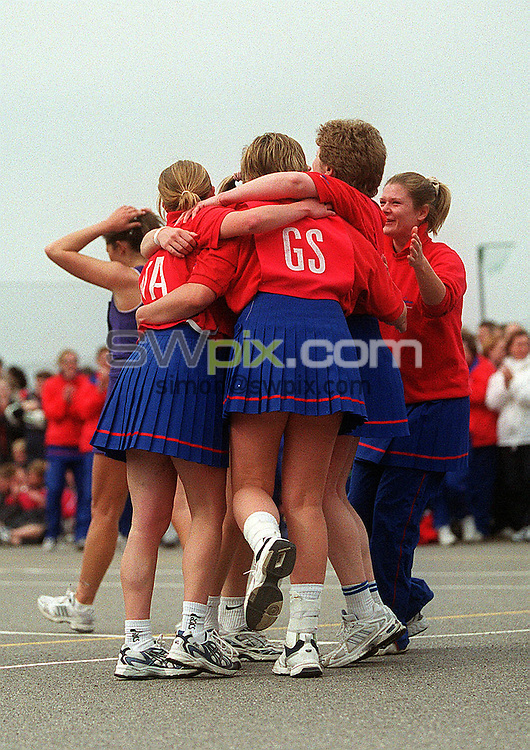Pix: Matthew Lewis/SWpix.com. Netball. Inter County Tournament 2003. Bournemouth School for Girls, Castle Gate Close, Bournemouth. 13/04/03...COPYRIGHT PICTURE>>SIMON WILKINSON>>01943 436649>>..Generic action. 'The Final', Birmingham celebrate thier win over Essex Metropolitan.