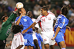 7 June 2007: El Salvador goalkeeper Juan Gomez (far left) punches the ball off the head of teammate Alfredo Pacheco (19) as Trinidad's Darryl Roberts (14) tries to make a play. The National Team of El Salvador defeated the National Team of Trinidad & Tobago 2-1 at the Home Depot Center in Carson, California in a first round game in the CONCACAF Gold Cup.