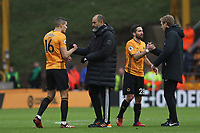 Wolverhampton Wanderers Manager Nuno Espirito Santo with Conor Coady of Wolverhampton Wanderers and Graham Potter Head Coach of Brighton & Hove Albion with João Moutinho of Wolverhampton Wanderers at the end of the game. Wolverhampton Wanderers vs Brighton & Hove Albion, Premier League Football at Molineux on 7th March 2020