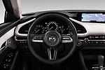 Car pictures of steering wheel view of a 2020 Mazda Mazda3 Skycruise 4 Door Sedan Steering Wheel