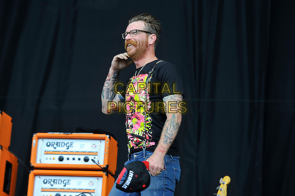 Jesse Hughes of Eagles of Death Metal.performing on Day 3 at Reading Festival, Reading, England. .26th August 2012.on stage in concert live gig performance performing music half length black t-shirt glasses beard stubble facial hair glasses side profile tattoos .CAP/MAR.© Martin Harris/Capital Pictures.