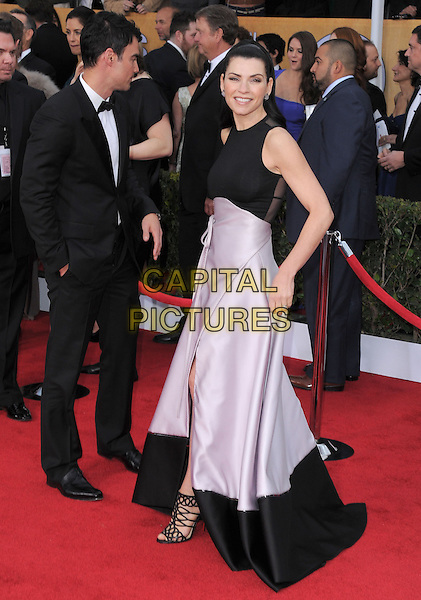 Julianna Margulies.Arrivals at the 19th Annual Screen Actors Guild Awards at the Shrine Auditorium in Los Angeles, California, USA..27th January 2013.SAG SAGs full length black white sleeveless pink skirt slit split strappy sandals  .CAP/DVS.©DVS/Capital Pictures.