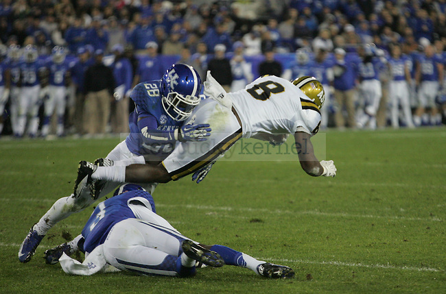 UK safety Eric Dixon (28) catches Alabama State wide receiver Jamel Johnson (8) in a mid-air tackle during UK's homecoming game vs. Alabama State at Commonwealth Stadium in Lexington, Ky., on Saturday, November 2, 2013. Photo by Adam Pennavaria | Staff
