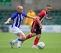 Lincoln City's Jack Payne vies for possession with Sheffield Wednesday's Barry Bannan<br /> <br /> Photographer Chris Vaughan/CameraSport<br /> <br /> Football Pre-Season Friendly - Lincoln City v Sheffield Wednesday - Saturday July 13th 2019 - Sincil Bank - Lincoln<br /> <br /> World Copyright © 2019 CameraSport. All rights reserved. 43 Linden Ave. Countesthorpe. Leicester. England. LE8 5PG - Tel: +44 (0) 116 277 4147 - admin@camerasport.com - www.camerasport.com