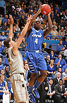 SIOUX FALLS, SD - MARCH 10:  Frank Gaines #4 from IPFW shoots over Dante Williams #2 from Oakland in the second half of their quarterfinal game Sunday night at the 2013 Summit League Basketball Tournament in Sioux Falls, SD.  (Photo by Dave Eggen/Inertia)