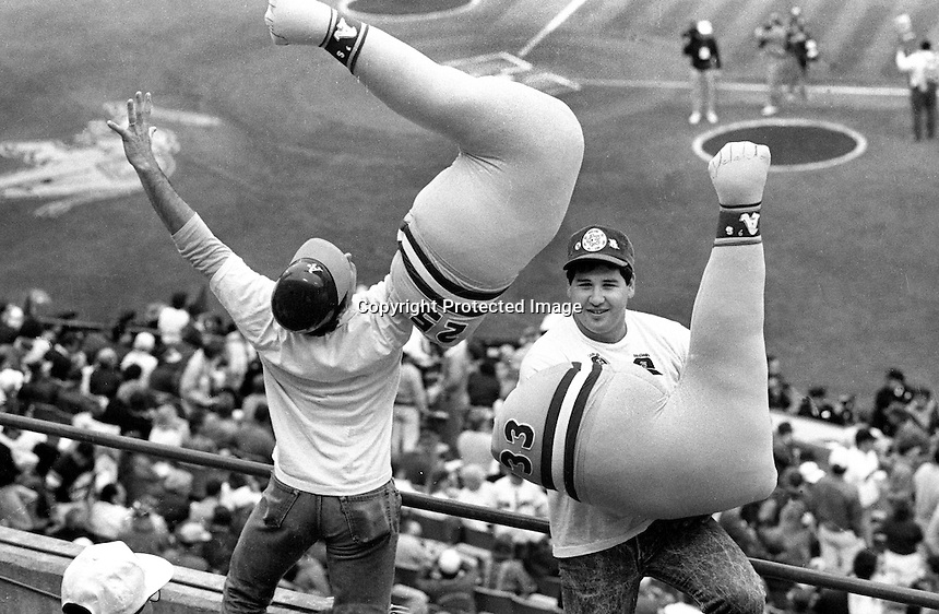 "Two Oakland Athletics fans imitate the ""Bash Bros."" at the A's vs. San Francisco Giants World Series opener in Oakland. (1989 photo by Ron Riesterer)"