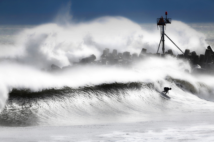 Waves wash across Manasquan Inlet during the infamous 'Doomsday Swell' surf days after Hurricane Sandy pummeled the Jersey Shore.