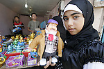"""Corombo, a puppet from the popular Egyptian version of the American crime fiction TV series """"Columbo"""" is displayed for sale holding a """"fanus"""", the traditional Ramadan lantern, during preparing for Islam's holy month of Ramadan in Gaza City on August 19, 2009. Ramadan is a Muslim religious observance that takes place during the ninth month of the Islamic calendar, believed to be the month in which the Quran began to be revealed. It is the Islamic month of fasting, in which Muslims don't eat or drink anything from sunrise 'till sunset. Fasting is meant to teach the person patience and humility. Photo By Abed Rahim Khatib"""