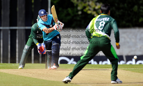 Scotland V Pakistan ODI - at Reaburn Place (Grange CC) Edinburgh - new Scotland Captain Kyle Coetzer gets the ball away off the bowling of Mohammad Hafeez on his way to making 32 in the game and top-scoring for the Scots - picture by Donald MacLeod - 17.05.13 - 07702 319 738 - clanmacleod@btinternet.com - www.donald-macleod.com