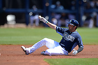 Tampa Bay Rays outfielder David DeJesus (7) slides into second during a spring training game against the Minnesota Twins on March 2, 2014 at Charlotte Sports Park in Port Charlotte, Florida.  Tampa Bay defeated Minnesota 6-3.  (Mike Janes/Four Seam Images)