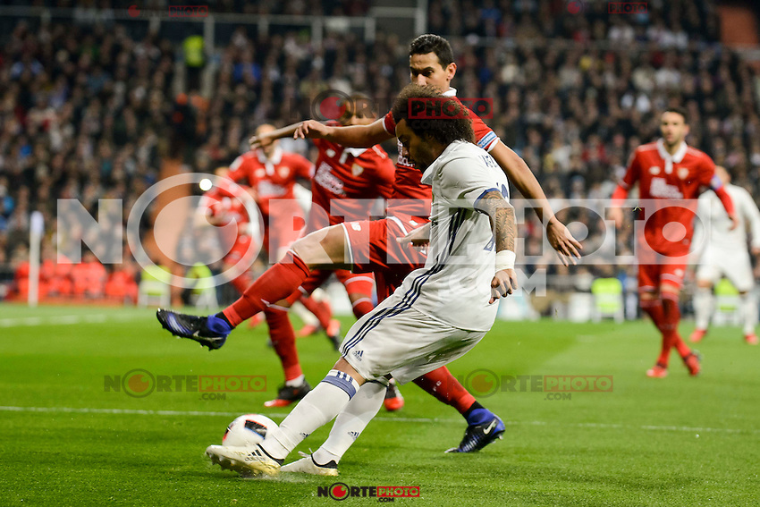 Real Madrid's Marcelo and Sevilla FC's Luciano Vietto during Copa del Rey match between Real Madrid and Sevilla FC at Santiago Bernabeu Stadium in Madrid, Spain. January 04, 2017. (ALTERPHOTOS/BorjaB.Hojas) NortePhoto.com