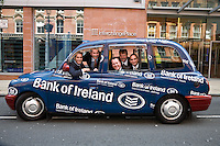 Five Bankers from bank of Ireland Birmingham pictured in a taxi outside their offices at Interchange Place.
