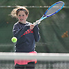 Merri Kelly Hannity of Cold Spring Harbor returns a volley from Hewlett's Kseniya Zonova during the Nassau County varsity girls' tennis singles final at Eisenhower Park on Sunday, October 18, 2015. Hannity, an eighth grader, finished second in the county tournament to Zonova and qualified for the state championship tournament.<br /> <br /> James Escher