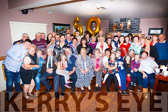 Julie and Johnny O'Connell of Scartaglin (seated centre) celebrating their 50th wedding anniversary with their family and friends at O'Riada's Bar on Saturday night last.
