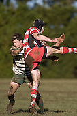 Mark Selwyn challenges Baden Kerr as he ckears for touch only to be penalised for a late tackle. Counties Manukau Premier rugby game between Karaka & Manurewa played at the Karaka Domain on July 5th 2008..Karaka won 22 - 12.