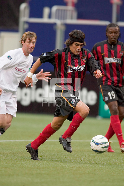 The MetroStars' Sergio Galvan Rey is chased by New England Revolution's Steve Ralston as Fabian  Taylor watches. The New England Revolution played the NY/NJ MetroStars to a 1 to 1 tie at Giant's Stadium, East Rutherford, NJ, on April 25, 2004.