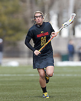 University of Maryland midfielder Brooke Griffin (11) brings the ball forward. .University of Maryland (black) defeated Boston College (white), 13-5, on the Newton Campus Lacrosse Field at Boston College, on March 16, 2013.