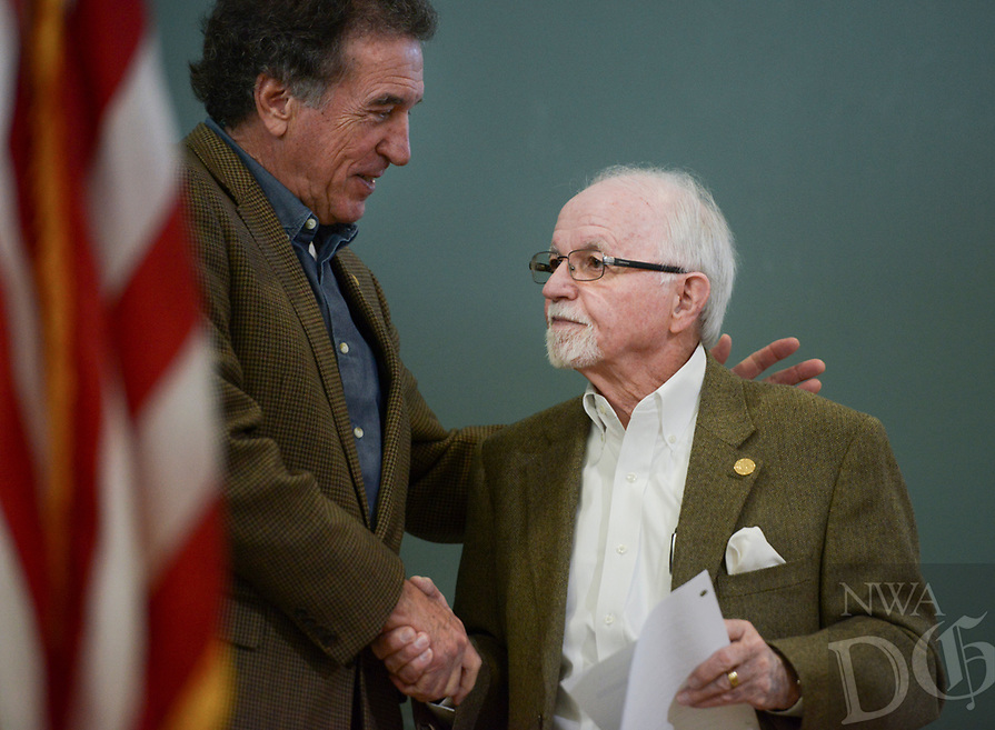 NWA Democrat-Gazette/CHARLIE KAIJO Arkansas Highway Commissioner Robert Moore shakes hands with outgoing Arkansas Highway Commission Chair Dick Trammel (from left) after his speech during a ribbon cutting, January 4, 2019 at the Jones Center in Springdale. <br />