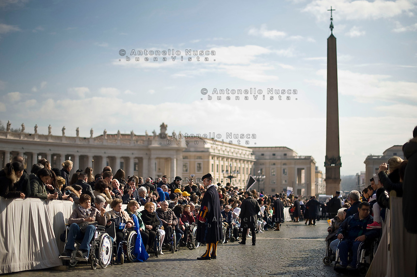 Vatican City, Vatican, March 16, 2016. <br /> Fedeli in sedia a rotelle in attesa dell'arrivo di Papa Francesco in Piazza San Pietro.<br /> Wheel-chair user faithful waiting in St. Peter's Square to attend the general audience.