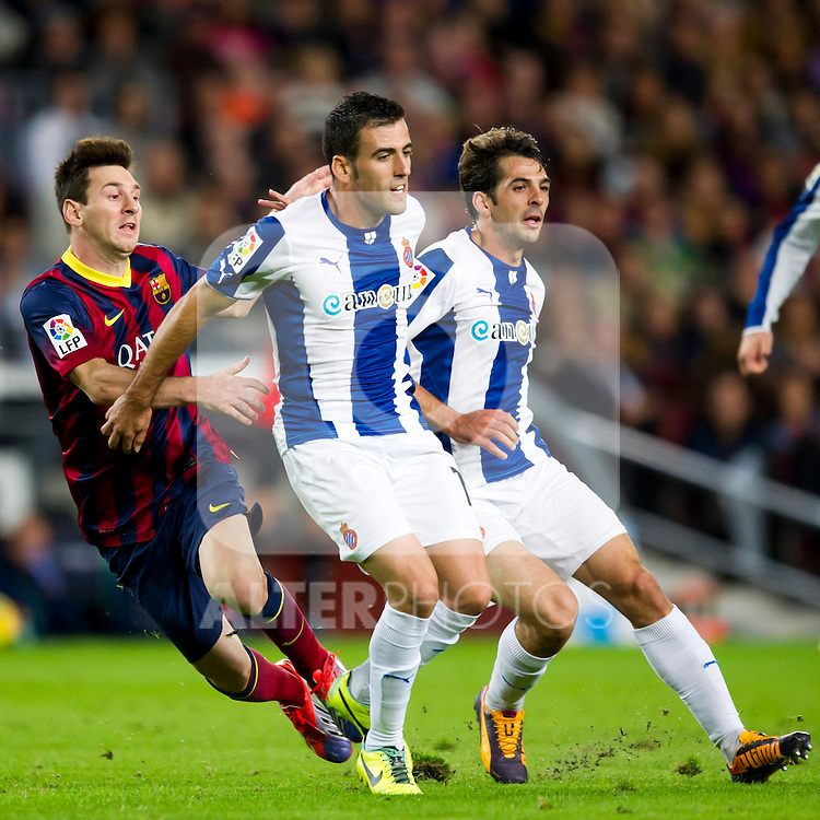 FC Barcelona's Leo Messi (left) and RCD Espanyol's Juan Fuentes (center) and Victor Sanchez (right) during La Liga 2013-2014 match. November 1, 2013. (ALTERPHOTOS/Alex Caparros)