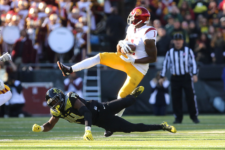 Nov 21, 2015; Eugene, OR, USA; Oregon Ducks cornerback Ugo Amadi (14) make a play on USC Trojans wide receiver Darreus Rogers (1) at Autzen Stadium. <br /> Photo by Jaime Valdez