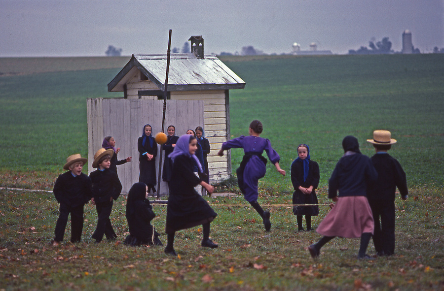 Amish children play jumprope high water at recess, Lancaster, PA