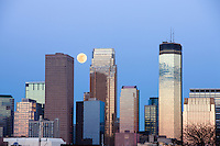 Minneapolis skyline and full moon in early spring from the West looking East, Minneapolis, Minnesota, USA.