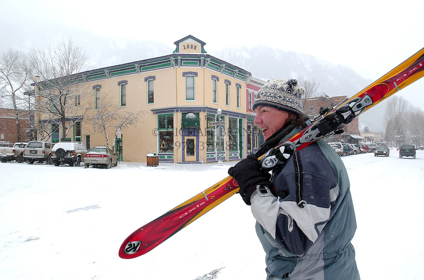 Skiers walk through downtown Aspen, CO on their way to the mountain. © Michael Brands. 970-379-1885.