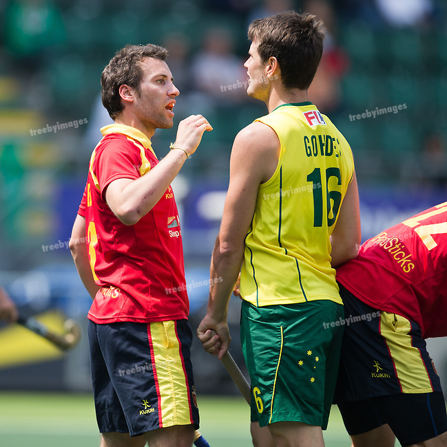Hockey World Cup 2014<br /> The Hague, Netherlands <br /> Day 3 Mens Australia v Spain<br /> Serg Enrique (L) and Matt Gohdes in action<br /> Photo: Grant Treeby<br /> www.treebyimages.com.au