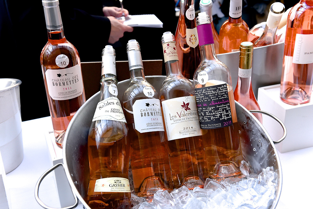 Still life photo of bottles of rosé wines on ice.