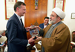 Peter Prove (left) director of international affairs for the World Council of Churches, receives a memento from Yusef El-Nasar, a Shia Muslim leader, during the visit of an international ecumenical delegation to Baghdad, Iraq, on January 21, 2017. The encounter took place at St Gregory the Illuminator Armenian Orthodox Church. The memento shows images of Muslim troops helping place crosses on Christian churches following the defeat of the Islamic State group in Iraq.