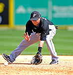 28 February 2007: Florida Marlins' infielder Alfredo Amezaga fields some grounders prior to a pre-season Grapefruit League game against the St. Louis Cardinals on Opening Day for Spring Training at Roger Dean Stadium in Jupiter, Florida. The Cardinals and Marlins share Roger Dean Stadium and the training facilities which opened in 1998 as a co-development between the Cardinals and the Montreal Expos.<br /> <br /> Mandatory Photo Credit: Ed Wolfstein Photo