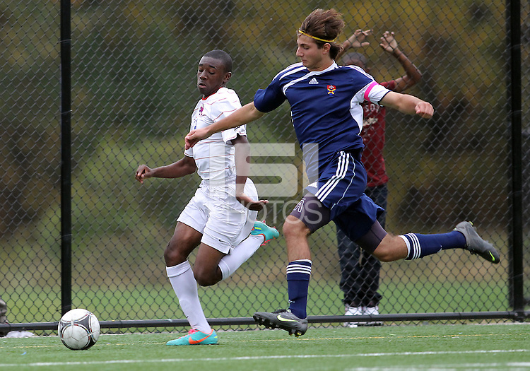 HYATTSVILLE, MD - OCTOBER 26, 2012:  Chris Odoi-Atsem (18) of DeMatha Catholic High School races for the ball against Camyer Matini (5) of St. Albans during a match at Heurich Field in Hyattsville, MD. on October 26. DeMatha won 2-0.