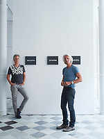 Timothy Haynes (left) and Keven Roberts, interior designers, in front of a trio of paintings by On Kawara.
