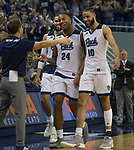 Nevada seniors Cody Martin (11), Jordan Caroline (24) and  Caleb Martin (10) are greeted by head coach Eric Musselman as they come off the floor at Lawlor Events Center for the last time at the end of their NCAA college basketball game against San Diego State in Reno, Nev., Saturday, March 9, 2019. (AP Photo/Tom R. Smedes)