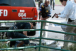 "(9-20-01) SAN BERNARDINO--A SECTION OR METRO--TAKE DOWN--San Bernardino Police officers and parole agents detain suspect Andreas Chavez, 24, who was barricaded in the E-Z 8 Motel on South Waterman Avenue in San Bernardino, Thursday. The Chavez walked out of the motel with his arm around a woman, named Christina Patterson, 19, of Redlands, attempting to elude police. San Bernardino Detective Bill Hanley, far right, spotted and approached him. Hanley then yelled,""Get down on the ground!"" and the arrest followed as seen above. STAFF PHOTO BY Rodrigo Pe-a."