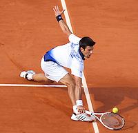 Novak Djokovic (SRB) (3) agaist Jurgen Melzer (AUS) (22) in the quarter finals of the men's singles. Jurgen Melzer beat Novak Djokovic 3-6 2-6 6-2 7-6 6-4..Tennis - French Open - Day 11 - Wed 02 June 2010 - Roland Garros - Paris - France..© FREY - AMN Images, 1st Floor, Barry House, 20-22 Worple Road, London. SW19 4DH - Tel: +44 (0) 208 947 0117 - contact@advantagemedianet.com - www.photoshelter.com/c/amnimages