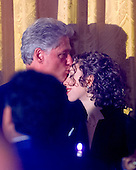 United States President Bill Clinton kisses the forehead of his daughter Chelsea following his remarks at the White House Millennium dinner in Washington, D.C. on December 31, 1999. .Credit: Ron Sachs / CNP.