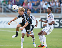 Stanford, California - Saturday June 30, 2012: Steven Lenhart heads the ball during a game at Stanford Stadium, Stanford, Ca.San Jose Earthquakes defeated Los Angeles Galaxy,  4 to 3