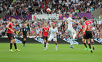 Pictured: Gylfi Sigurdsson of Swansea heads the ball back Sunday 30 August 2015<br /> Re: Premier League, Swansea v Manchester United at the Liberty Stadium, Swansea, UK