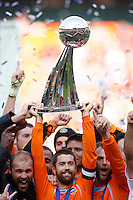 Houston Dynamo defender (24) Wade Barrett holds the Alan I. Rothenberg Trophy aloft during post-game celebrations. The Houston Dynamo defeated the New England Revolution 2-1 in the finals of the MLS Cup at RFK Memorial Stadium in Washington, D. C., on November 18, 2007.
