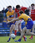 Tommy Durnin of Louth scores a goal despite Jamie Malone and Cillian Brennan of Clare during their national League game in Cusack Park. Photograph by John Kelly.