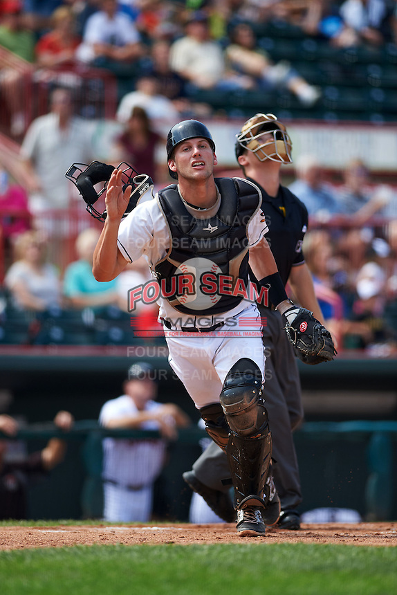 Erie Seawolves catcher Drew Longley (38) looks for a foul ball popup during a game against the Harrisburg Senators on August 30, 2015 at Jerry Uht Park in Erie, Pennsylvania.  Harrisburg defeated Erie 4-3.  (Mike Janes/Four Seam Images)