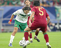 Jose Fonseca (17) of Mexico puts a move on Meira Fernando (5) of Portugal. Portugal defeated Mexico 2-1 in their FIFA World Cup Group D match at FIFA World Cup Stadium, Gelsenkirchen, Germany, June 21, 2006.