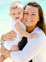 Local mom Alyssa and baby Emma on beach in the morning light.