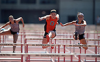 Apr 11, 2015; Los Angeles, CA, USA; Rachael Hinkel of Occidental College (center) places third in 16.28 in the womens 100m hurdles in a SCIAC multi dual meet at Occidental College. From left: Courtney Crain (Redlands), Hinkel and Elise Waters (Redlands). Photo by Kirby Lee