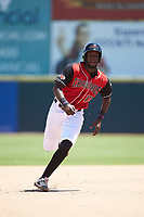 Sherten Apostel (13) of the Hickory Crawdads hustles towards third base against the Charleston RiverDogs at L.P. Frans Stadium on May 13, 2019 in Hickory, North Carolina. The Crawdads defeated the RiverDogs 7-5. (Brian Westerholt/Four Seam Images)