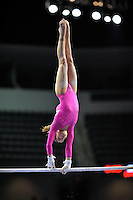 02/20/09 - Photo by John Cheng for USA Gymnastics.  US gymnast Mackenzie Caquatto performs on uneven bars in a meet against Japan before the Tyson American Cup at Sears Centre Arena in Chicago.