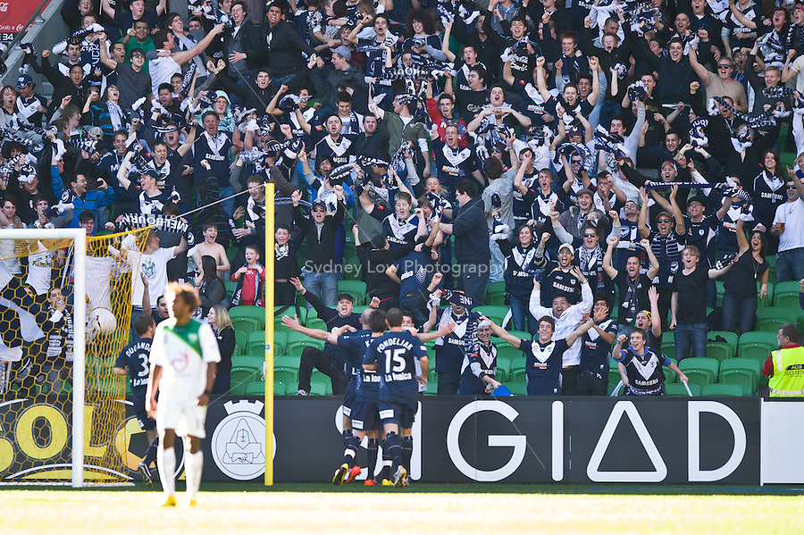 MELBOURNE, AUSTRALIA - AUGUST 22, 2010: Fans from the Victory celebrate a goal in Round 3 of the 2010 A-League between the Melbourne Victory and North Queensland Fury at AAMI Park on August 22, 2010 in Melbourne, Australia. (Photo by Sydney Low / Asterisk Images)