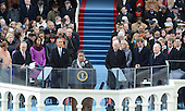 President Barack Obama watches Myrlie Evers-Williams deliver the invocation before being sworn-in for a second term as the President of the United States by Supreme Court Chief Justice John Roberts during his public inauguration ceremony at the U.S. Capitol Building in Washington, D.C. on January 21, 2013.     .Credit: Pat Benic / Pool via CNP